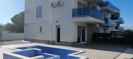Semi – detached house with garden and pool