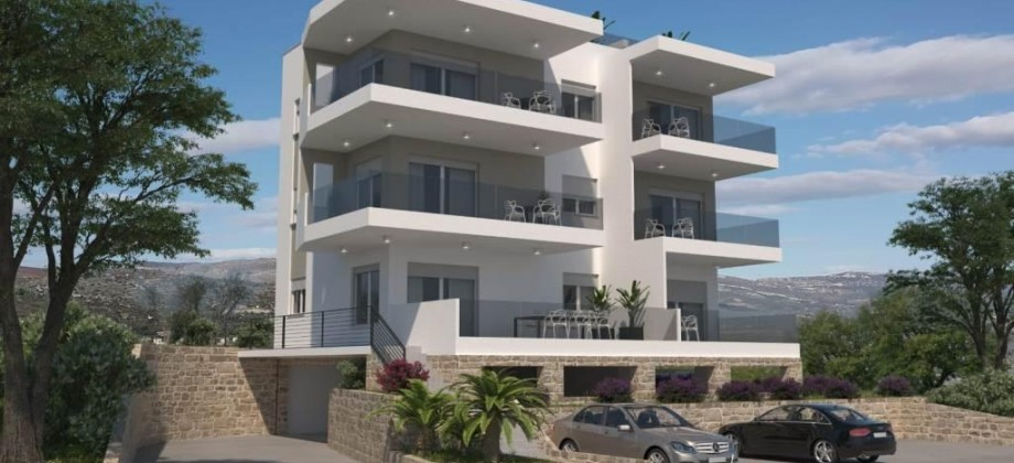 For sale penthouse apartment with a private roof terrace and with open sea view!